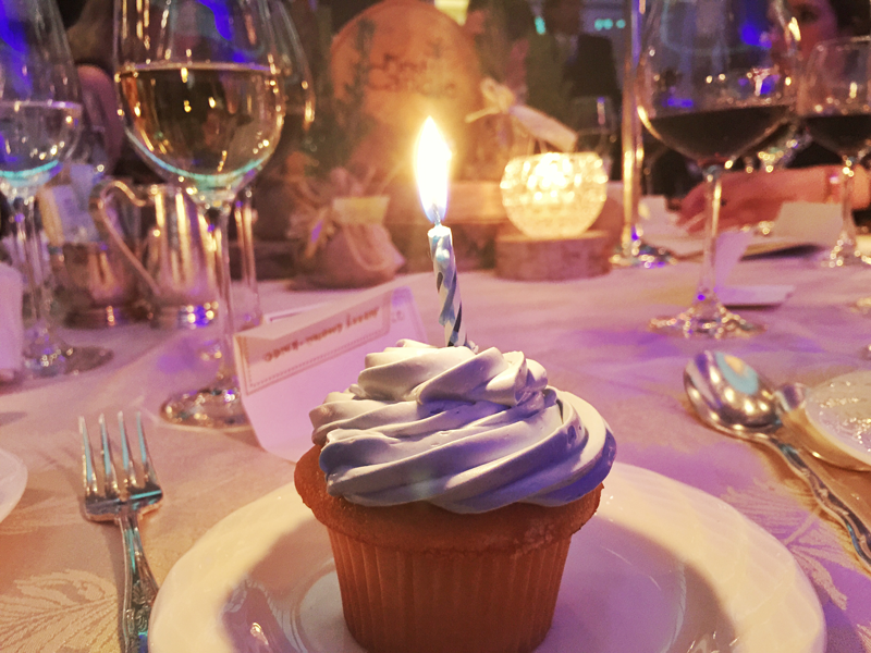 Cupcakes with a single candle were given to guests to represent every baby's first birthday.